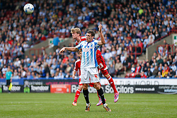 Mark Hudson of Huddersfield and Patrick Bamford of Middlesbrough compete in the air - Photo mandatory by-line: Rogan Thomson/JMP - 07966 386802 - 13/09/2014 - SPORT - FOOTBALL - Huddersfield, England - The John Smith's Stadium - Huddersfield town v Middlesbrough - Sky Bet Championship.