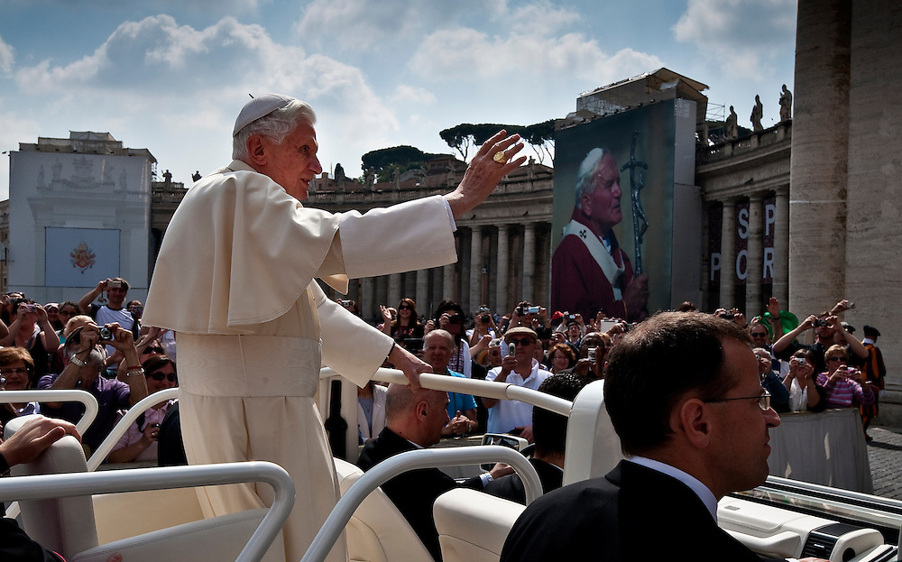 Pope Benedict XVI waves to visitors at St. Peter's Square as he arrives for a papal audience May 4. (Sam Lucero photo)