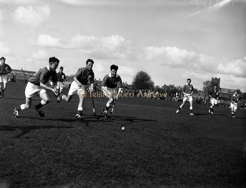 09/04/1960<br /> 04/09/1960<br /> 09 April 1960<br /> Hockey: Ireland v Wales Schoolboys Hockey International at Londonbridge Road, Sandymount, Dublin. Picture shows P. Bewley (left)  ofNewtown, Waterford  hitting the ball towards the Welsh goalmouth under pressure from a welsh back (centre) with W.H. McVeigh (right) of Royal Belfast Academical Institution in support.