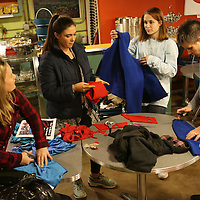 Lauren Wood | Buy at photos.djournal.com<br /> Leigh Ann Hussey, from left, Peyton Curtis, Emily Finch and Jennifer Martin cut up donated sweaters and sweatpants into sweaters that dogs can wear Monday night at Cafe 212. The sweaters were donated to the Tupelo-Lee Humane Society.