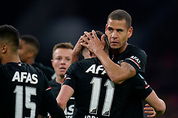 Oussama Idrissi #11 of AZ Alkmaar scores and celebrate with Ramon Leeuwin #27 of AZ Alkmaar during the Dutch Eredivisie match round 25 between Ajax Amsterdam and AZ Alkmaar at the Johan Cruijff Arena on March 01, 2020 in Amsterdam, Netherlands