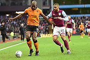 Wolverhampton Wanderers defender (on loan from Porto ) Willy Boly (15) on defensive duties  against Aston Villa striker (on loan from Bournemouth) Lewis Grabban (45) during the EFL Sky Bet Championship match between Aston Villa and Wolverhampton Wanderers at Villa Park, Birmingham, England on 10 March 2018. Picture by Dennis Goodwin.