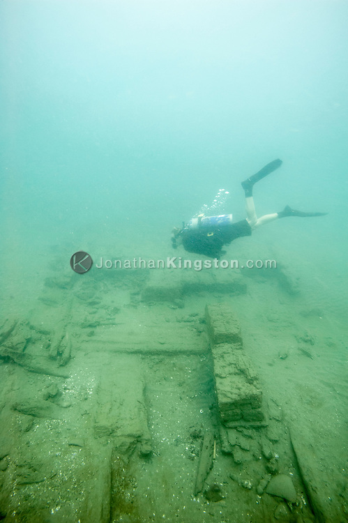 Graduate research assistant Jacob Hooge SCUBA dives over the wooden hull of the Encarnación, a cargo vessel that was part of the 17th century Spanish Tierra Firme fleet in Panama.