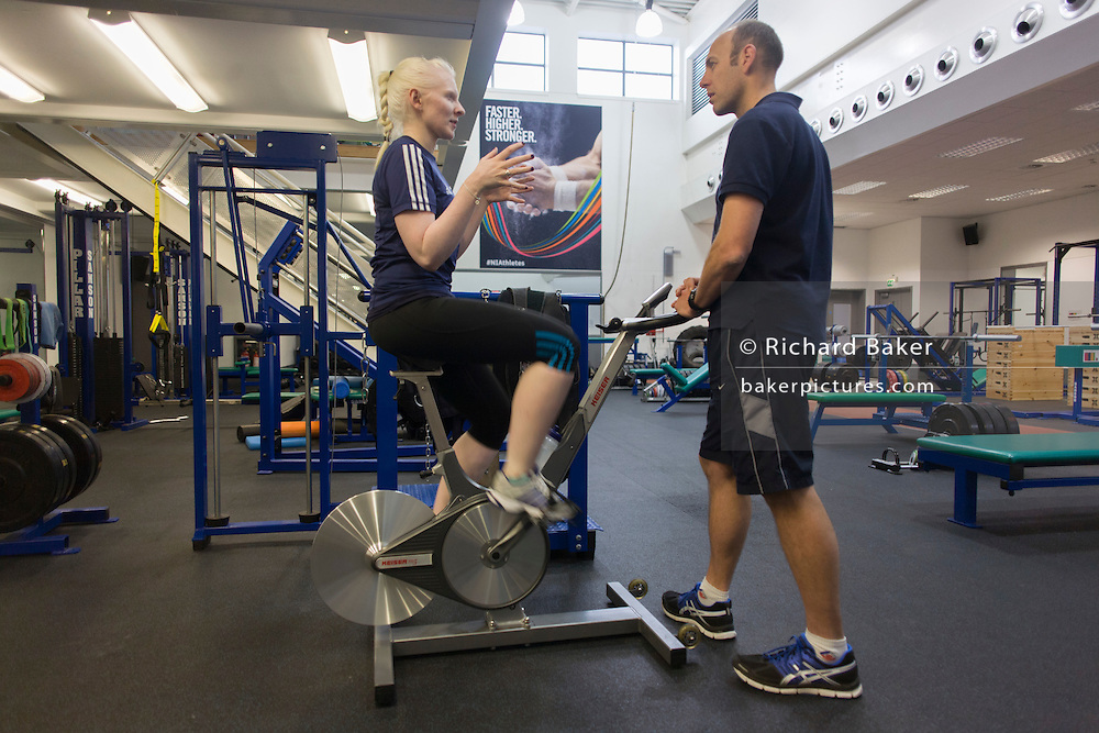 Partially-sighted skiing paralympian from the Sochi Olympics, Kelly Gallagher trains with her trainer in the gym at the Sports Institute, University of Ulster, Northern Ireland, UK.
