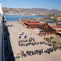 Voyagers line up to board the MV Explorer on Embarkation day for the Semester at Sea Spring 2014 Voyage, January 10th 2014, in Ensenada, Mexico.