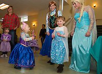 "Alya Balint and Addy Beane do their ""Let It Go"" dance as they meet Elsa and Anna during their tea party at the Gilford Community Center Saturday morning.  (Karen Bobotas/for the Laconia Daily Sun)"