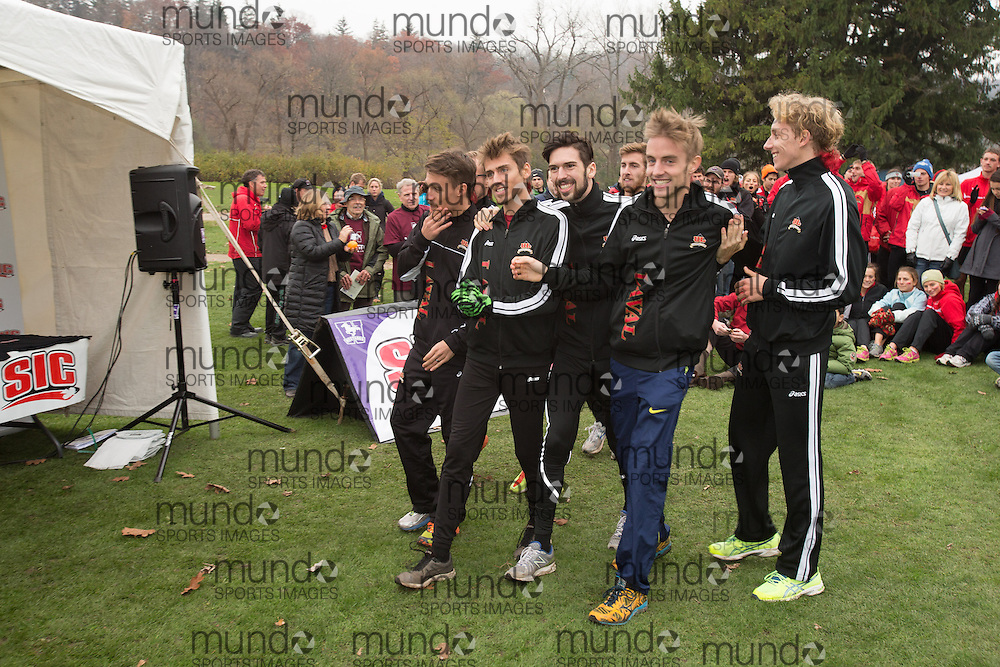 London, Ontario ---2012-11-10--- The Laval Men's team celebrate after winning the silver medal at the 2012 CIS Cross Country Championships at Thames Valley Golf Course in London, Ontario, November 10, 2012. .GEOFF ROBINS Mundo Sport Images