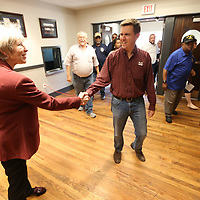Lynn Spruill, Mayor of Starkville, greets Ben Lang, of Starkville, as he and others enter the renovated Starkville Police Department for a tour and refreshments during the grand opening of the building on Friday morning in Starkville.