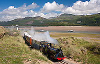 Train with Barmouth Bridge in background<br /> Fairbourne Steam Railway<br /> Gwynedd<br /> Mid<br /> Narrow Gauge<br /> Rail<br /> Transport