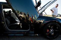 JEROME A. POLLOS/Press..Harry Cosseboom views one of the newer cars on display Friday at the River City Rod Run.