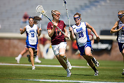 Virginia Tech Hokies D Sam Voelker (17) is defended by Duke Blue Devils M/A Emma Hamm (26).  The #3 seeded Duke Blue Devils defeated the #6 seeded Virginia Tech Hokies 19-6 in the first round of the 2008 Women's ACC Lacrosse Tournament held at the University of Virginia's Scott Stadium in Charlottesville, VA on April 24, 2008.