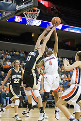 Virginia's Siedah Williams (4) knocks the ball out of the hands of Wake Forest's Corienne Groves (33).  The Cavaliers defeated the Demon Deacon 77-71 on January 11, 2007 for their first ACC win in the John Paul Jones Arena in Charlottesville, VA.<br />