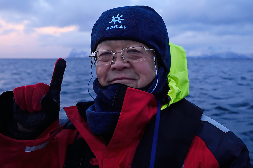 Whale watching and photography visitor/ecotourist Mr Chen jianwei from China on m/s Ylajali, outside Senja, Troms county, Norway, Scandinavia