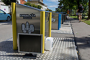 Recycling bins on a street in the Slovenian capital, Ljubljana, on 27th June 2018, in Ljubljana, Slovenia. Recycling contractor Snaga collects and separates waste Snaga collects waste in the area of the City of Ljubljana and nine municipalities in the vicinity. Bins are loacted around the capital for the following materials: Waste paper and carton, glass and packaging (collection unit, and recently introduced packaging and paper bins at collection sites); biological waste in brown bins at collection sites), bulky waste (free removal upon order, paid removal upon order collection centre); hazardous waste (movable collection unit, collection unit at the Povsetova collection centre); waste electrical and electronic equipment (collection centre, movable collection unit – for small items only) and other waste (black or grey bins at collection sites).