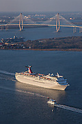 Aerial showing Carnival Cruise Lines ship departing Charleston Harbor with the Ravenel Bridge in the background in Charleston, SC.