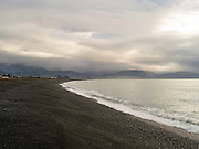 A grey, overcast winter view of Kaikoura Beach, Canterbury, New Zealand