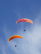 Ellenville, NY - A pair of paragliders soar in the sky on Oct. 25, 2009.