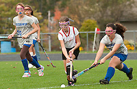 Laconia's Alexis Albert and Gilford's Kassy Weston go after the ball during Middle School Field Hockey action at Opechee Thursday afternoon.   (Karen Bobotas/for the Laconia Daily Sun)