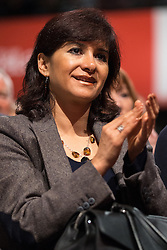 © Licensed to London News Pictures . 29/09/2015 . Brighton , UK . LAURA ALVAREZ ( Jeremy Corbyn's wife ) applauds Jeremy Corbyn as he delivers his speech to the 2015 Labour Party Conference . Photo credit : Joel Goodman/LNP