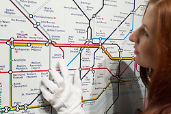 © Licensed to London News Pictures. 13/09/2013. London, UK. A Sotheby's employee exmines Simon Patterson's 'The Great Bear' (1992) (est. GB£12,000-18,000), a lithograph based on the famous London underground tube map with station names changed using each line to represent groups of people, including scientists, saints, philosophers, comedians, explorers and footballers, at the press view for Sotheby's 'Prints and Multiples Sale' on New Bond Street in London today (13/09/2013). The auction, set to take place on the 17th of September, includes works by Munch, Rembrandt, Basquiat, Warhol and Picasso. Photo credit: Matt Cetti-Roberts/LNP