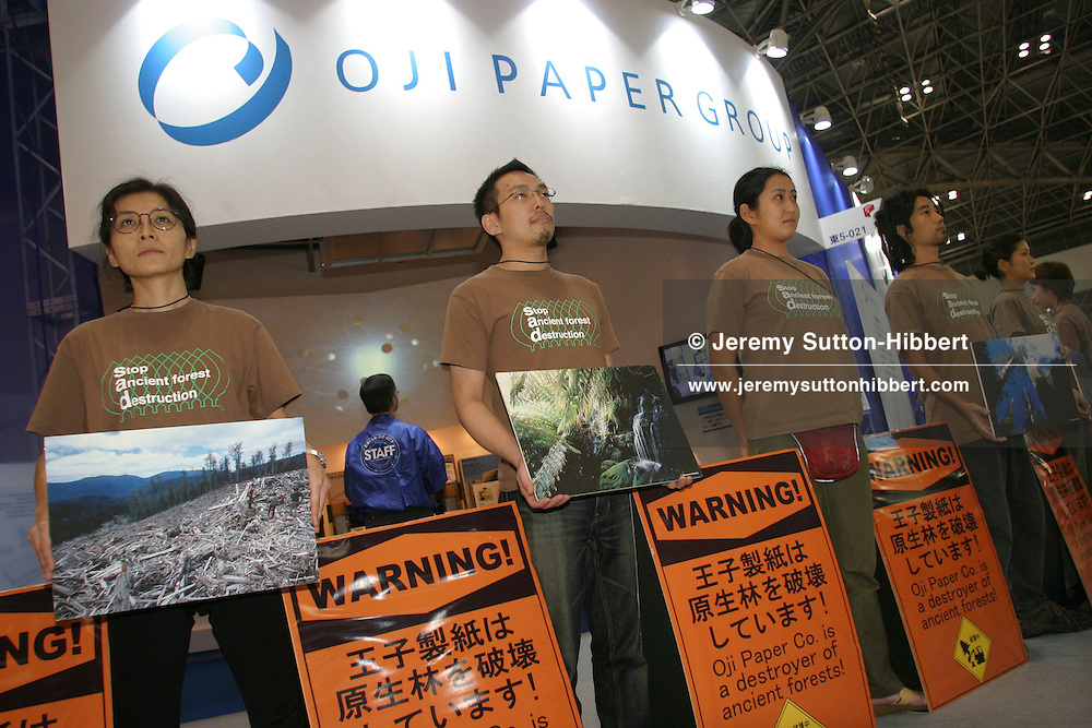 Greenpeace volunteers and staff demonstrate against the destruction of ancient rainforests by Japanese paper company 'Oji Paper Co.', at Tokyo Pack 2004 Expo, at Tokyo Big Sight, Tokyo, Japan, 05.10.04