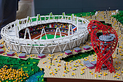 © Licensed to London News Pictures. 05/07/2012. London, UK. A minature LEGO replica of the Olympic stadium and Orbit. LEGO creator, Warren Elsmore used around 250,000 standard LEGO bricks to create a miniature replica of the London 2012 Olympic Games Park. The model took Warren, aged 35 from Edinburgh, 300 hours to construct and is on display at the 'Visit Denmark' Olympic Village  at St Katharine Docks, London. Photo credit : Vickie Flores/LNP