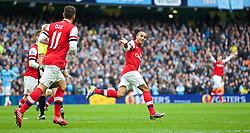 14.12.2013, Etihad Stadium, Manchester, ENG, Premier League, Manchester City vs FC Arsenal, 16. Runde, im Bild Arsenal's Theo Walcott celebrates scoring the first equalising goal against Manchester City // during the English Premier League 16th round match between Manchester City and Arsenal FC at the Etihad Stadium in Manchester, Great Britain on 2013/12/14. EXPA Pictures © 2013, PhotoCredit: EXPA/ Propagandaphoto/ David Rawcliffe<br /> <br /> *****ATTENTION - OUT of ENG, GBR*****