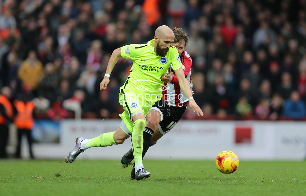 Brentford defender Maxime Colin during the Sky Bet Championship match between Brentford and Brighton and Hove Albion at Griffin Park, London, England on 26 December 2015.