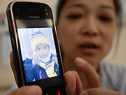 WUHAN, CHINA - APRIL 02: (CHINA OUT) <br /> <br /> 7-year-old Boy Donates Kidney To His Mother After he Died<br /> <br /> Zhou Lu shows the picture of her son in her mobile phone at Jingzhou City°Øs Tongji Hospital on April 2, 2014, in Wuhan, Hubei Province of China. Chen Xiaotian, a 7-year-old boy died from malignant brain tumors at 4 a.m. on April 02, 2014. He donated his left kidney to his mother Zhou Lu who suffered from uremia and can only cured by a kidney transplant. Chen was diagnosed with malignant brain tumor when he was five-and-a-half years old and has lost his vision in both eyes early this year due to the exacerbation of his brain tumors. Chen also donated his right kidney to a 21-year-old woman and his liver to a 27-year-old man. The operation was both completed on Wednesday.<br /> ©Exclusivepix