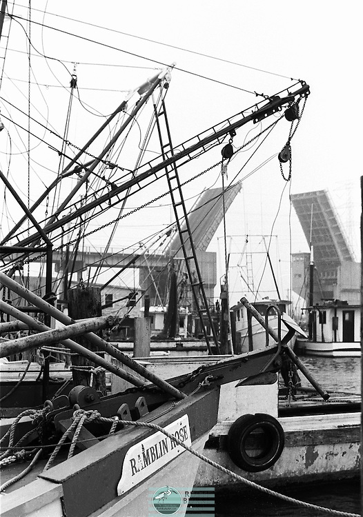 Shrimp boats in 1978 on the Kemah and Seabrook waterfronts on the Texas Gulf Coast. Includes the Ramblin rose boat and the draw bridge that was replaced in 1986.