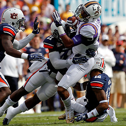October 22, 2011; Baton Rouge, LA, USA; Auburn Tigers cornerback Chris Davis (11) tackles LSU Tigers wide receiver Rueben Randle (2) during the first half at Tiger Stadium.  Mandatory Credit: Derick E. Hingle-US PRESSWIRE / © Derick E. Hingle 2011