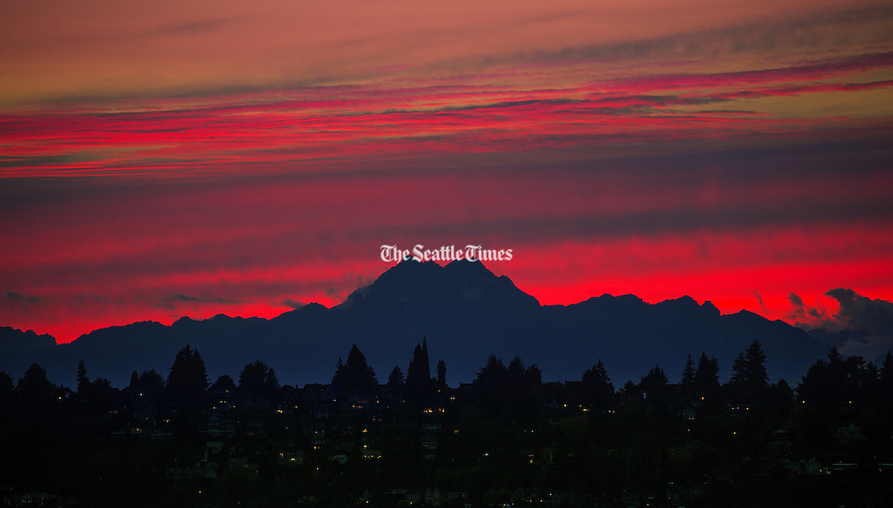 Brothers, a prominent pair of peaks in the Olympic Mountains, stand out during an evening's sunset in this view from the Kirkland waterfront. Brothers are located near the Hood Canal and are part of the Olympic Mountain Range. (Mike Siegel / The Seattle Times)
