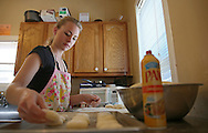 Co-owner Emily Hamilton places formed kolaches on a pan at The Kettel House Bakery & Cafe in Marion on Tuesday, June 18, 2013.