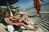 Tourists sit out in the sun at a resort in Isla Grande, one of the islands in an archipelago known as Islas del Rosario, about 35km southwest of Cartagena, on Colombia's Caribbean coast on January 2, 2009. (Photo/Scott Dalton)