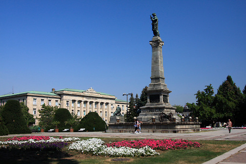 Monument of Freedom; Freedom Square, flowers, bank beyond, colorful; Ruse; Bulgaria; summer