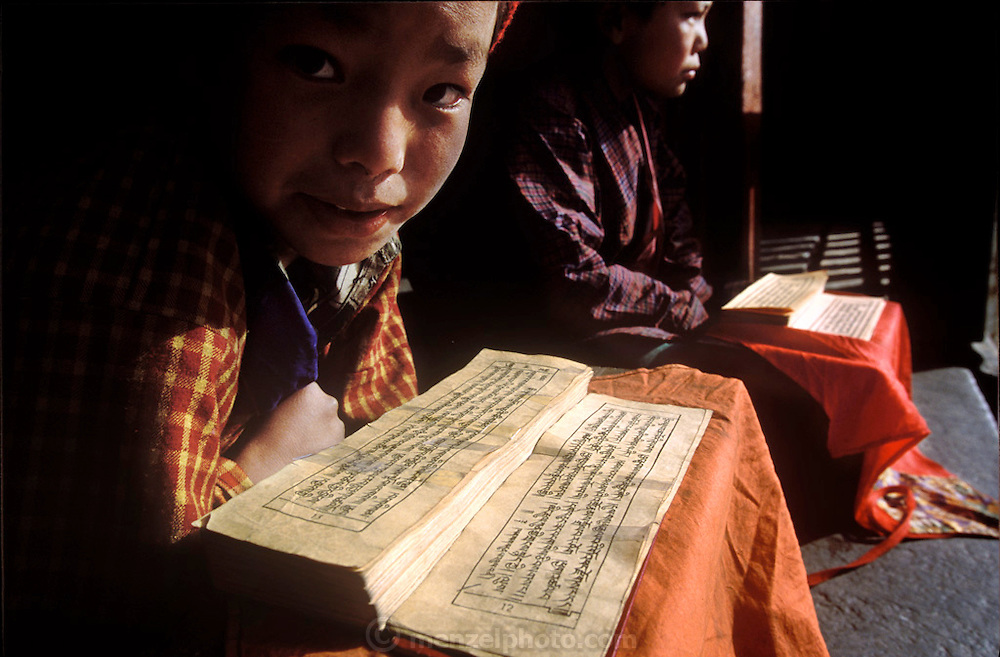 Young monks at the Gangte Goemba Monastery in Bhutan read holy Buddhist scripts in the cold morning air. Hungry Planet: What the World Eats (p. 279).
