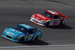 Mar 11, 2012; Las Vegas, NV, USA;  Sprint Cup Series driver Matt Kenseth (17) and driver Kurt Busch (51) during the Kobalt Tools 400 at Las Vegas Motor Speedway. Mandatory Credit: Jason O. Watson-US PRESSWIRE