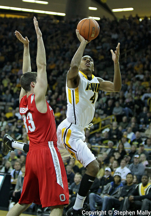 January 04 2010: Iowa Hawkeyes guard/forward Roy Devyn Marble (4) puts up a shot as Ohio State Buckeyes guard Jon Diebler (33) defends during the first half of an NCAA college basketball game at Carver-Hawkeye Arena in Iowa City, Iowa on January 04, 2010. Ohio State defeated Iowa 73-68.