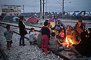 Greece, Idomeni, Refugees on their way to Europe - Eye of a Needle, Idomeni<br /> <br /> Kurdish Syrian famiies sitting around a open fireplace at the trainstation in Idomeni.<br /> <br /> Nadeloehr nach Nordeuropa Idomeni, der Grenzuebergang ist seit Tagen gesperrt,. <br /> Es ensteht im provisorischen Fluechtlingslager in Idomeni eine ngespannte Lage. <br /> Daueregen und Kaelte machen vor allem den Familien mit kleinen Kindern zu schaffen. <br /> <br /> Idomeni, is the eye of a needle for getting to nothern Europe. <br /> The FYRO macedonian authorities, closed the border from Greece completely. The situation close to the border gets more and more difficult. The People have to sleep outside or in small tents. <br /> Heavy rainfalls and cold nights are treating the refugees badly. Some already stayed up to ten nights at Idomeni. There is not enough food and supplies to help about 14.000 refugees.<br /> <br /> <br /> <br /> keine Veroeffentlichung unter 50 Euro*** Bitte auf moegliche weitere Vermerke achten***Maximale Online-Nutzungsdauer: 12 Monate !! <br /> <br /> for international use:<br /> Murat Tueremis<br /> C O M M E R Z  B A N K   A G , C o l o g n e ,  G e r m a n y<br /> IBAN: DE 04 370 800 40 033 99 679 00<br /> SWIFT-BIC: COBADEFFXXX