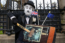 © Licensed to London News Pictures. 27/03/2019. London, UK. An pro-Brexit protester dressed as a clown demonstrates outside Houses of Parliament. Later today the MPs will votes on series of indicative votes on alternatives to Prime Minister Theresa May's Brexit deal. Photo credit: Dinendra Haria/LNP