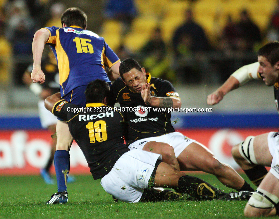 Wellington's Masefau Leuluniu and Anthony Perenise tackle Ben Smith.<br /> Air NZ Cup Ranfurly Shield match - Wellington Lions v Otago at Westpac Stadium, Wellington, New Zealand. Friday, 31 July 2009. Photo: Dave Lintott/PHOTOSPORT
