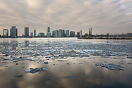 Ice in the Hudson River at dusk with the  Jersey City skyline.