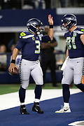 Seattle Seahawks quarterback Russell Wilson (3) high fives Seattle Seahawks tight end Nick Vannett (81) after Wilson runs for a 4 yard third quarter touchdown that gives the Seahawks a 12-10 lead pending a two point conversion attempt during the NFL football NFC wild card playoff game against the Dallas Cowboys on Saturday, Jan. 5, 2019 in Arlington, Tex. The Cowboys won the game 24-22. (©Paul Anthony Spinelli)