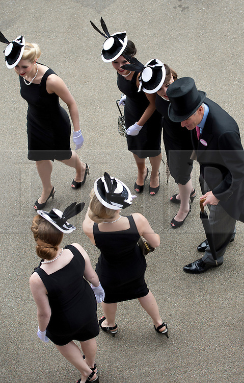 © London News Pictures. 20/06/2013. Ascot, UK.  Racegoers at Ladies Day on day three of Royal Ascot at Ascot racecourse in Berkshire, on June 20, 2013.  The 5 day showcase event,  which is one of the highlights of the racing calendar, has been held at the famous Berkshire course since 1711 and tradition is a hallmark of the meeting. Top hats and tails remain compulsory in parts of the course. Photo credit should read: Ben Cawthra/LNP