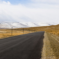 Deserted country road with electric posts, Tashkurgan County, Xinjiang, China