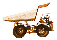 X-ray image of a mining dump truck (orange on white) by Jim Wehtje, specialist in x-ray art and design images.
