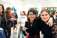 Mariluz Tejeda, center, of Youth for Change and Krystal Herrera of Artists Ink enjoy the December 5th opening of the Stories from Salinas exhibition at the CSUMB Salinas Center for Arts and Culture in Oldtown. The exhibition celebrates the mentors, youth and families of the Salinas Youth Initiative.