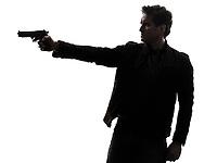one man killer policeman aiming gun silhouette studio white background