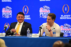 LSU Tigers head coach Ed Orgeron and LSU Tigers quarterback Joe Burrow (9) during the post game press conference after the Tigers defeated the Oklahoma Sooners in the 2019 College Football Playoff Semifinal at the Chick-fil-A Peach Bowl on Saturday, Dec. 28, in Atlanta. (Harrison McClary via Abell Images for the Chick-fil-A Peach Bowl)