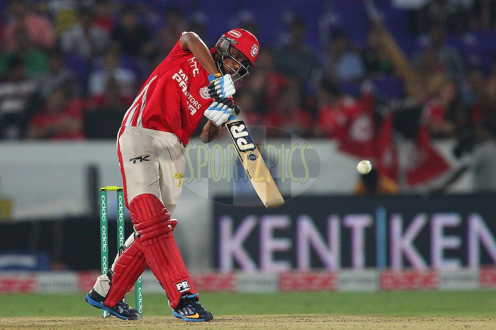 Akshar PATEL of the Kings XI Punjab hits over the top for four during the second semi final match of the Oppo Champions League Twenty20 between the Kings XI Punjab and the Chennai Superkings held at the Rajiv Gandhi Cricket Stadium, Hyderabad, India on the 2nd October 2014<br /> <br /> Photo by:  Ron Gaunt / Sportzpics/ CLT20<br /> <br /> <br /> Image use is subject to the terms and conditions as laid out by the BCCI/ CLT20.  The terms and conditions can be downloaded here:<br /> <br /> http://sportzpics.photoshelter.com/gallery/CLT20-Image-Terms-and-Conditions-2014/G0000IfNJn535VPU/C0000QhhKadWcjYs